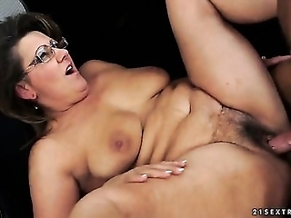 Mature Woman In Glasses Named Gigi M Gets Her Hairy Pussy Fucked By Young Neighbour