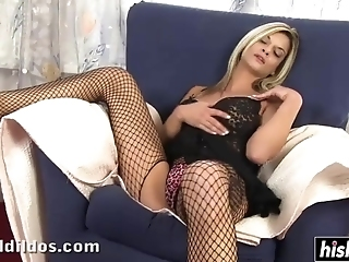Irresistible Blonde In Fishnet Stockings Masturbates